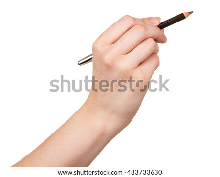 Black pencil makeup in a female hand isolated on white background.