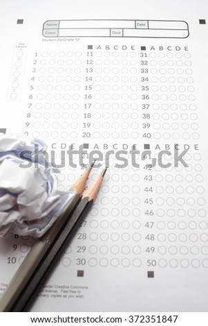 black Pencils lying on a computerized exam answer sheet.