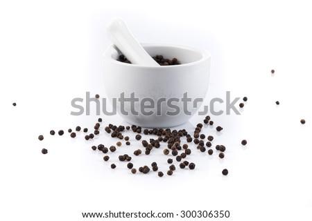 Black peper peppercorns in mortar and pestle - stock photo
