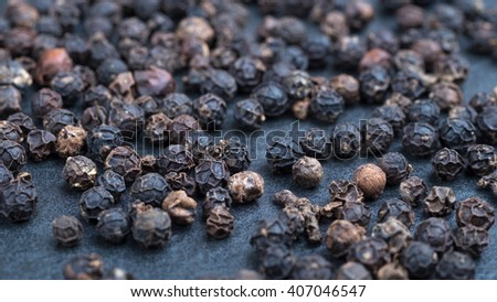 Black pepper corn. Macro image with shallow depth of field.