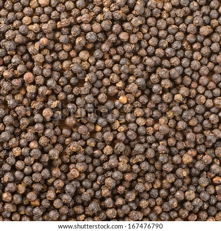 Black pepper grains as background   - stock photo