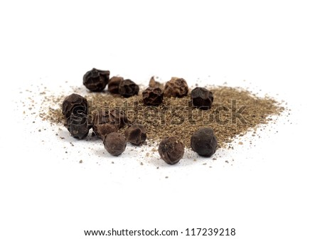 Black pepper on white - stock photo
