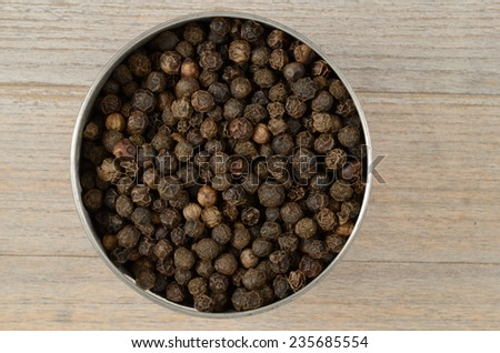 black pepper peas in a round saucer - stock photo