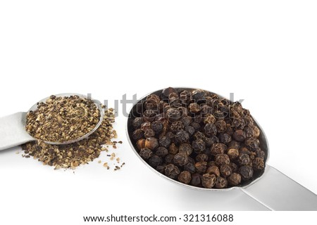 Black Peppercorns and Ground Pepper on white background - stock photo