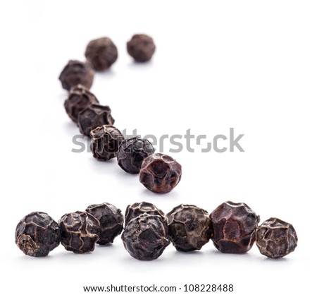 Black peppercorns isolated on white background. - stock photo
