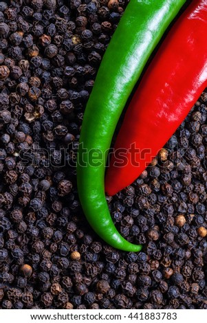 Black peppercorns with chili peppers detail