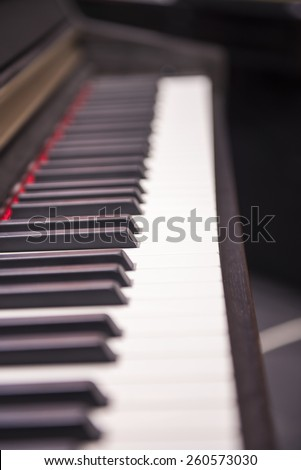 Black piano close-up blur background and foreground. - stock photo