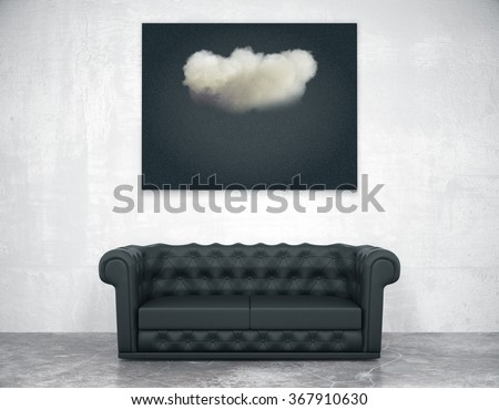 Black picture with cloud above black leather sofa in empty room with concrete floor - stock photo
