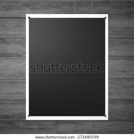 Black pinned poster on the vintage wood wall. 3d render - stock photo