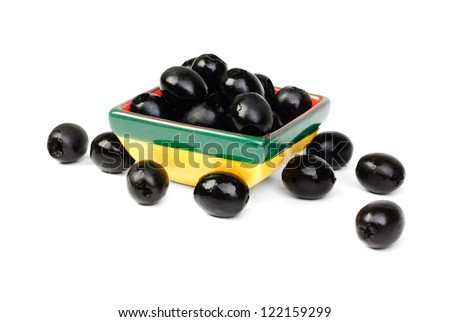 Black pitted olives in ceramic salad bowl isolated on white macro