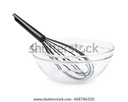 Black plastic french whisk in a glass bowl, composition isolated over the white background