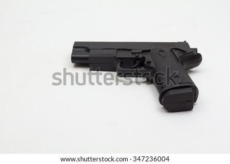 black plastic hand gun on white background - stock photo