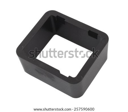 Black plastic rectangle with grooves on its sides