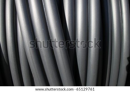 Black plastic tubes - construction site objects. PVC sewer pipes. - stock photo