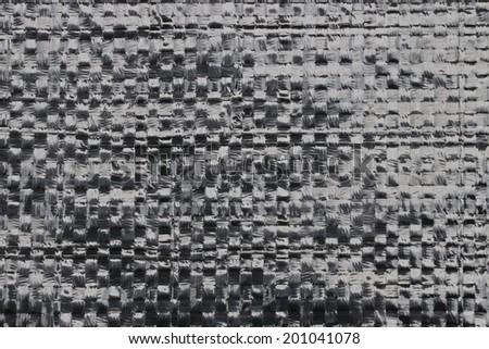 Black plastic woven - stock photo