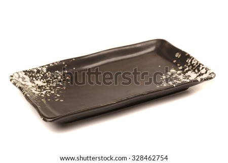 Black plate on white background  - stock photo