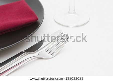 Black plate place setting with glass