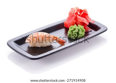 Black plate with shrimp sushi nigiri isolated - stock photo