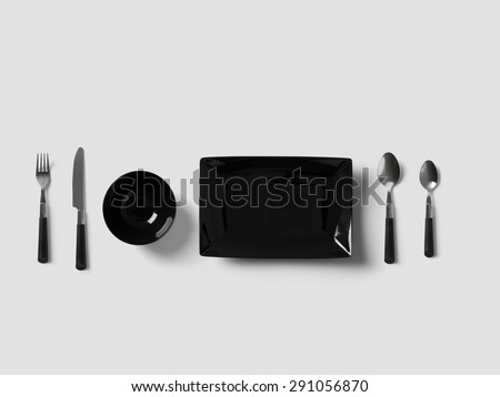 Black plates and silverware