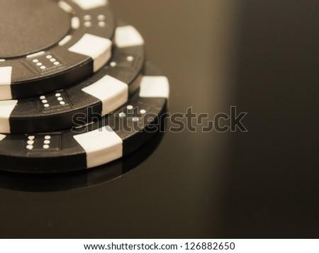 BLACK POKER CHIPS - stock photo