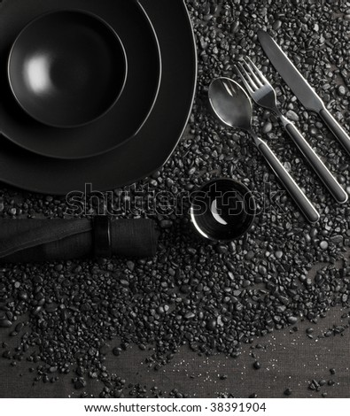 Black porcelain on the tablecloth - stock photo