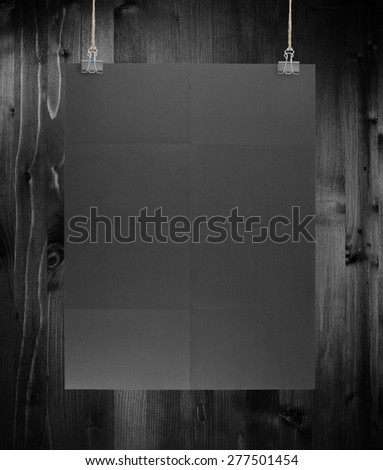 Black poster on a wood wall - stock photo