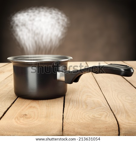 black pot and fog  - stock photo