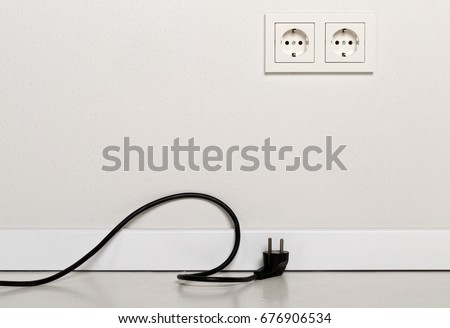 stock-photo-black-power-cord-cable-unplugged-with-european-wall-outlet-on-white-plaster-wall-with-copy-space-676906534.jpg