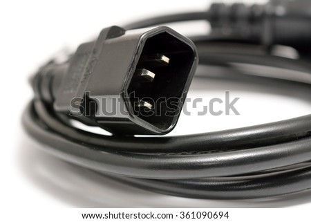 Black power cord with detail on the C14 connector on a white background.
