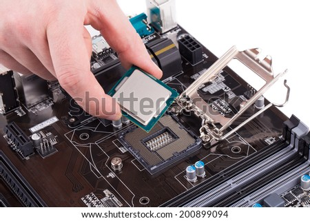 Black powerful motherboard with hand. Isolated on a white background. - stock photo