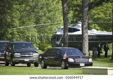 Black Presidential Limo with motorcade of black SUV's and Marine One Helicopter sitting on golf course in Williamsburg, Virginia on May 4, 2007, waiting for arrival of Her Majesty Queen Elizabeth II