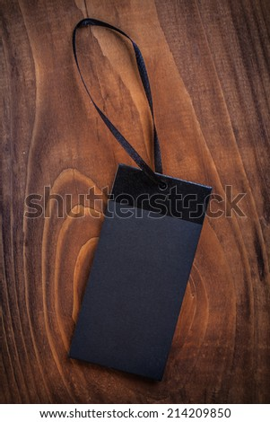 black price label tag on old wooden board - stock photo