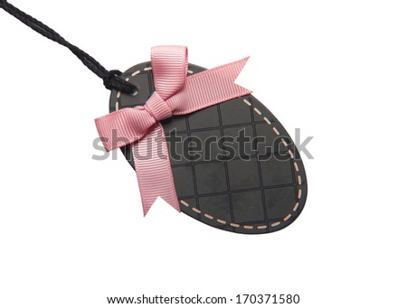 Black price tag or address label with beautiful pink bow.