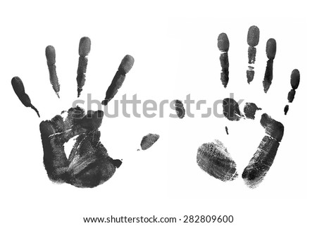 Black prints of human palms isolated on white - stock photo