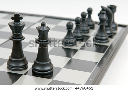black queen and king on a board - stock photo