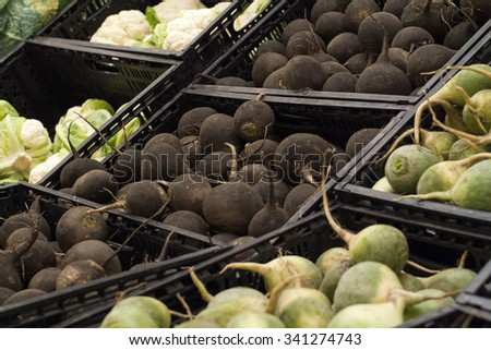 black radishes on shelf in store