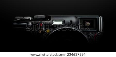 Black Rangefinder camera isolated on black  - stock photo