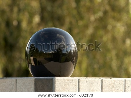 Black reflective ball used as fencepost