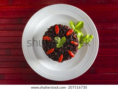 "Black rice called ""Venere rice"" on white plate"
