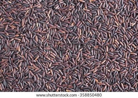 Black rice food background. - stock photo