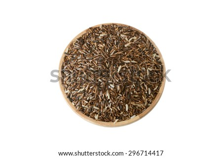 Black rice in the wooden plate isolated on white background with clipping path