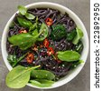 Black Rice Noodles with Chili and Spinach. - stock photo