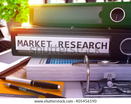 Black Ring Binder with Inscription Market Research on Background of Working Table with Office Supplies and Laptop. Market Research Business Concept on Blurred Background. 3D Render. - stock photo