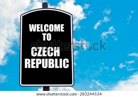 Black road sign with greeting message WELCOME TO CZECH REPUBLIC isolated over clear blue sky background with available copy space. Travel destination concept  image