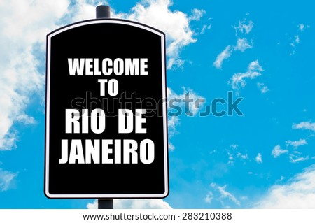 Black road sign with greeting message WELCOME TO  RIO DE JANEIRO isolated over clear blue sky background with available copy space. Travel destination concept  image