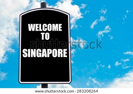 Black road sign with greeting message WELCOME TO SINGAPORE isolated over clear blue sky background with available copy space. Travel destination concept  image