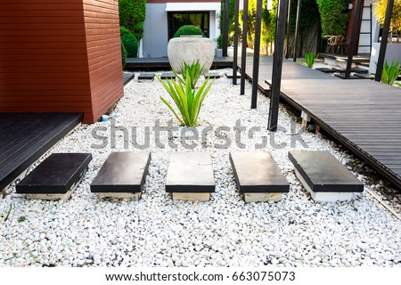 Pebbles And Stones For Gardens Black rocks walking way tropical garden stock photo royalty free black rocks walking way in tropical garden black stones garden path on white pebbles and workwithnaturefo