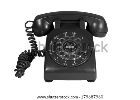Black rotary phone isolated on white