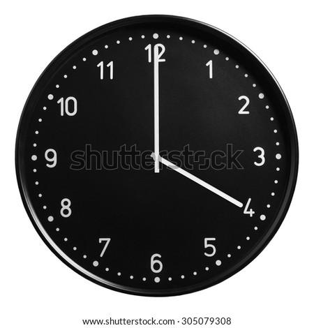 Black round clock showing four o'clock isolated on white background - stock photo