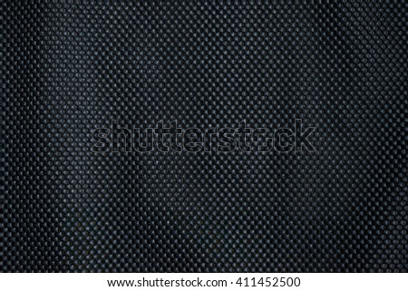 Black rubber dotted background